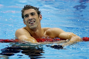 Michael Phelps of the U.S. smiles after winning his 19th Olympic medal in the men's 4x200m freestyle relay final during the London 2012 Olympic Games at the Aquatics Centre